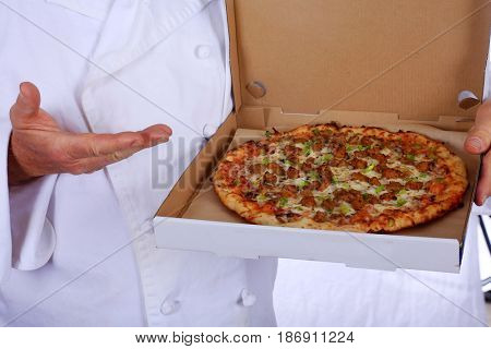 Pizza. Pizza Chef holds a pizza. Isolated on white. Room for text.