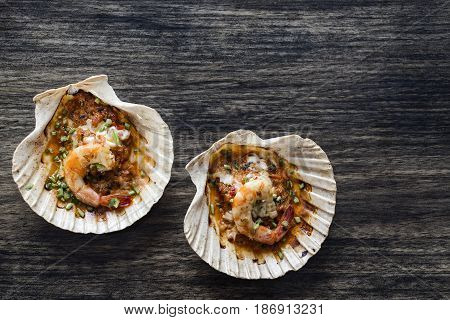gourmet cuisine baked king prawns in spicy tomato and herb sauce