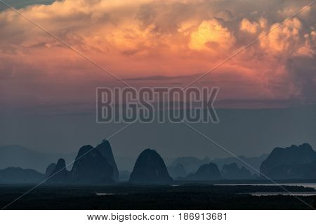 Sunset on the Phang Nga bay karst hills in the Andaman sea, Thailand