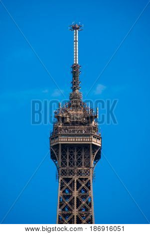 Spire peak of Eiffel Tower Tour Eiffel blue sky steel structure