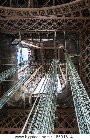 Standing under Eiffel Tower Tour Eiffel blue sky clouds