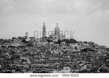 Town of Paris around Sacre Coeur on top of the hill black and white