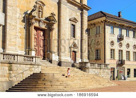 Little girl on the steps of the Church of St. Peter and St. Stephen (Chiesa Collegiata dei SS Pietro e Stefano) - Bellinzona, Switzerland, 16 July 2008
