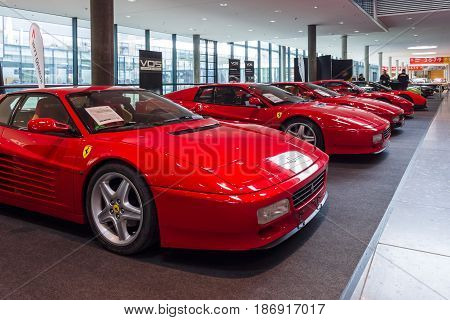 STUTTGART GERMANY - MARCH 03 2017: The various modifications of sports cars Ferrari Testarossa and F512 TR. Europe's greatest classic car exhibition