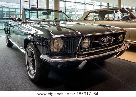STUTTGART GERMANY - MARCH 03 2017: Pony car Ford Mustang V8 Cabrio GT 1967. Europe's greatest classic car exhibition