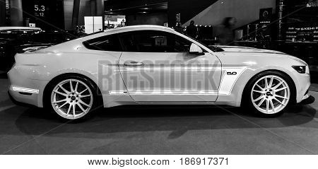 STUTTGART GERMANY - MARCH 03 2017: Pony car Ford Mustang GT AM2 Fastback Coupe 2016. Black and white.Europe's greatest classic car exhibition
