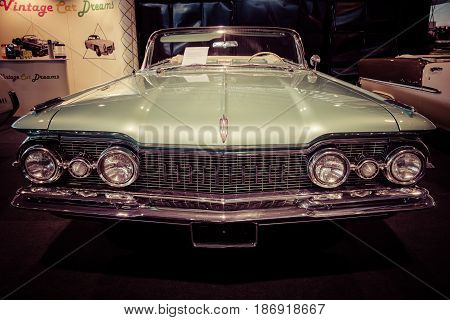 STUTTGART GERMANY - MARCH 03 2017: Full-size car Oldsmobile Super 88 Convertible 1959. Stylization. Vintage toning. Europe's greatest classic car exhibition