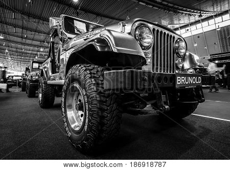 STUTTGART GERMANY - MARCH 03 2017: Compact sport utility vehicle Jeep CJ7 1980. Black and white. Europe's greatest classic car exhibition