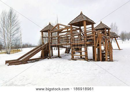 children's wood game lodge in the yard of the inhabited massif in winter