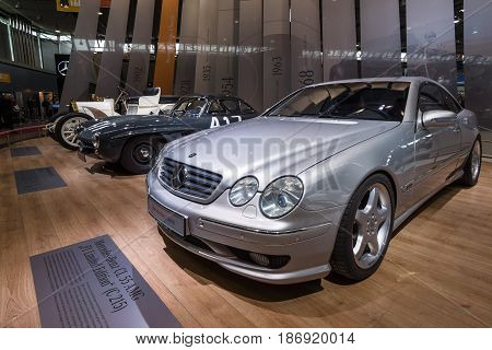 STUTTGART GERMANY - MARCH 03 2017: Mercedes-Benz CL 55 AMG (foreground) Mercedes-Benz 300SL (center) and Mercedes Simplex 40PS (background). Europe's greatest classic car exhibition