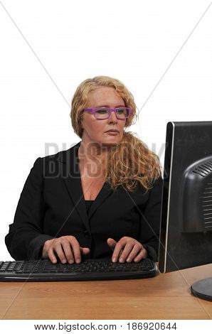 Woman executive or manager using a desktop computer