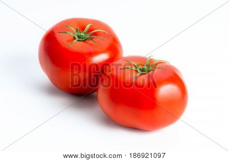 Pair of Red tomatoes isolated on white background