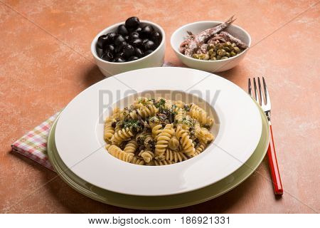 pasta with anchovies capers and black olives