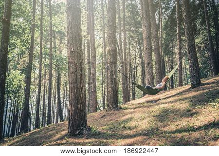 Sleeping woman relax. In the hammock. In the natural atmosphere in the park