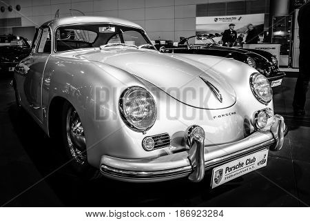 STUTTGART GERMANY - MARCH 03 2017: Luxury sports car Porsche 356 1955. Black and white. Europe's greatest classic car exhibition