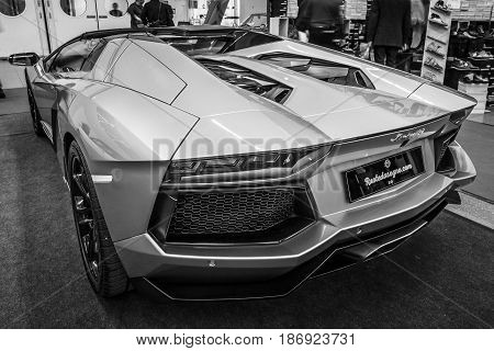 STUTTGART GERMANY - MARCH 03 2017: Sports car Lamborghini Aventador LP 700-4 2014. Rear view. Black and white. Europe's greatest classic car exhibition
