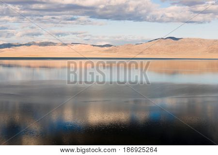 Walker Lake reflects Chukar Ridge and Mount Ferguson western USA