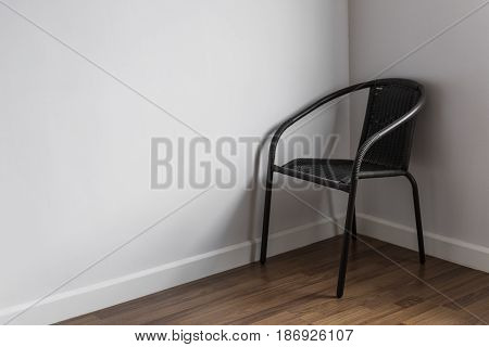 a chair stand alone in the corner of living room