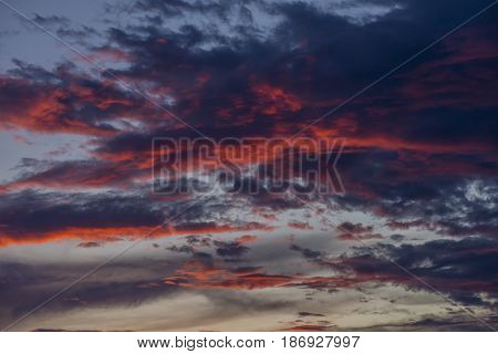 Blue sky with white and blue and pink clouds. Clear sky. Beautiful sky. Evening sky. Yellow and blue cloud in the sky.