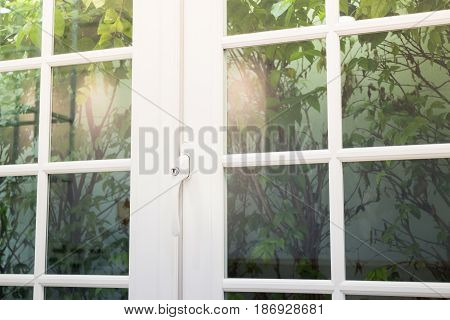 White Wooden Frame And Glass Door stock photo