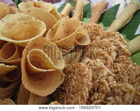 thai crispy golden curl and rice cracker, thailand traditional snack called Thong Pab and Khaotan