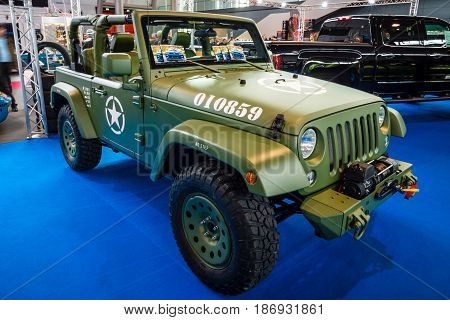STUTTGART GERMANY - MARCH 03 2017: Compact SUV Jeep Wrangler (US Army colored) 2017. Europe's greatest classic car exhibition