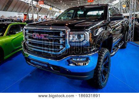 STUTTGART GERMANY - MARCH 03 2017: Heavy-Duty pickup truck GMC Sierra 1500 Crew Cab SLT 2017. Europe's greatest classic car exhibition