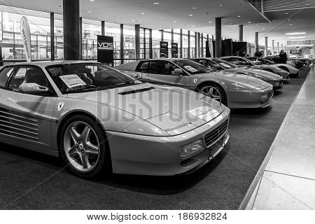 STUTTGART GERMANY - MARCH 03 2017: The various modifications of sports cars Ferrari Testarossa and F512 TR. Black and white. Europe's greatest classic car exhibition