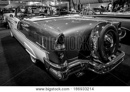 STUTTGART GERMANY - MARCH 03 2017: Full-size car Chevrolet Bel Air Convertible 1955. Rear view. Black and white. Europe's greatest classic car exhibition