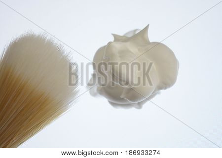 Shaving foam and shaving brush isolated on white background, pure, fresh