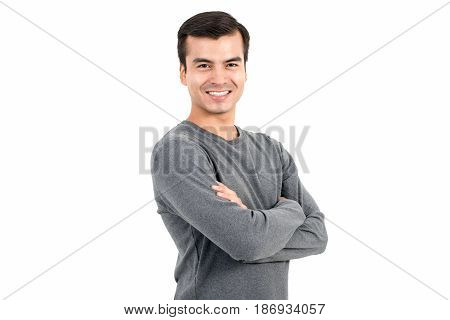 Portrait of happy smiling man wearing casual t-shirt crossing his arms - isolated on white background