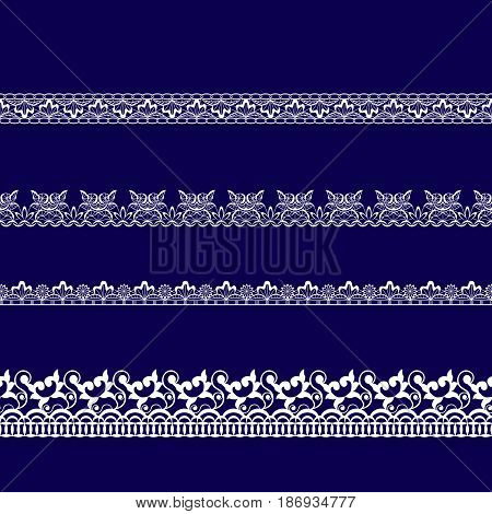set of white lace ribbons on a blue background