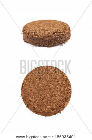 Compressed compost tablet isolated over the white background, set of two different foreshortenings