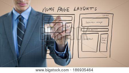 Digital composite of Business man mid section with marker and website mock up with flare against cream background