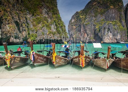 KO PHI PHI LEH, THAILAND, February 1, 2014: Traditional long tail boats on the beach of Maya Bay, Andaman Sea, famous tourist destination in the Ko Phi Phi achipelago