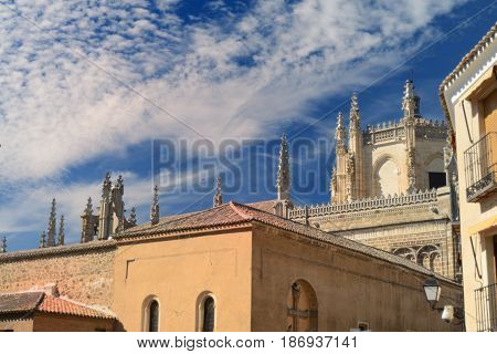 roofs of medieval buildings and tops of Cathedral in Toledo, Spain
