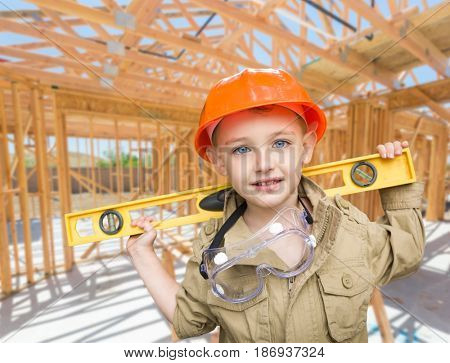 Young Boy Contractor With Level On Site Inside New Home Construction Framing.