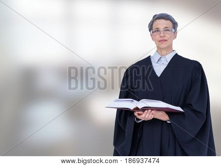 Digital composite of Judge holding book in front of office windows