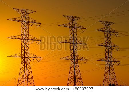 Power line towers at sunset