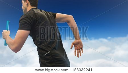 Digital composite of Relay runner against clouds and blue sky
