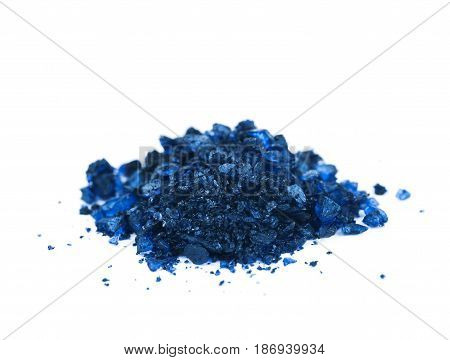 Pile of colored chemical salt crystals isolated over the white background