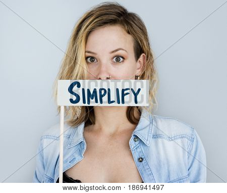 Adult Woman Showing Simplify Word Sign