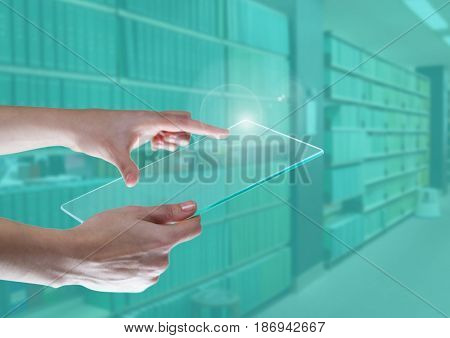 Digital composite of Hand touching a tablet in green library