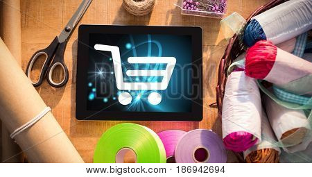 Digital composite of Shopping cart icon on digital tablet by craft products