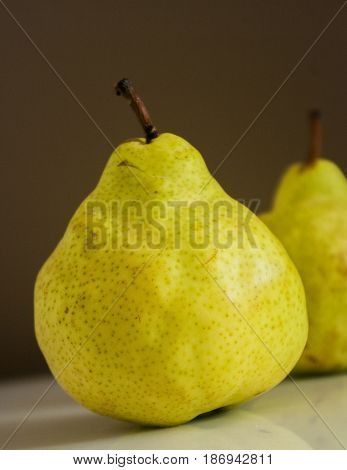 fresh pear on a black background close up