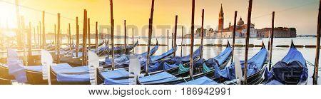 Gondolas moored by Saint Mark square with San Giorgio di Maggiore church in the background - Venice Venezia Italy Europe