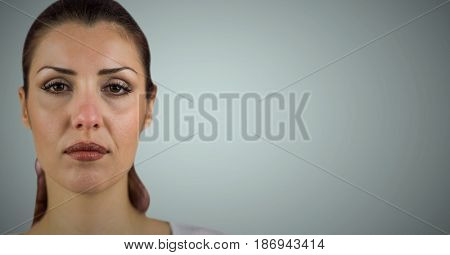 Digital composite of Woman's face after crying against light blue background