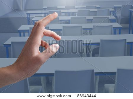 Digital composite of Hand Touching  air of classroom