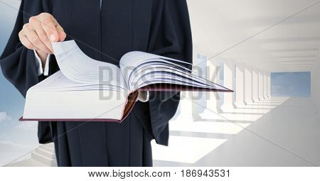 Digital composite of Midsection of judge holding law book