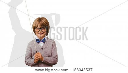 Digital composite of Digitally generated image of smiling boy holding stick with shadow of graduate student in background